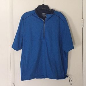 Greg Norman sports top